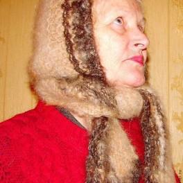 Шапка женская вязанная из пуха колли(шерсть собачья).Очень теплая шапка!